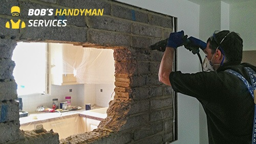 Handyman Drilling Into a Wall